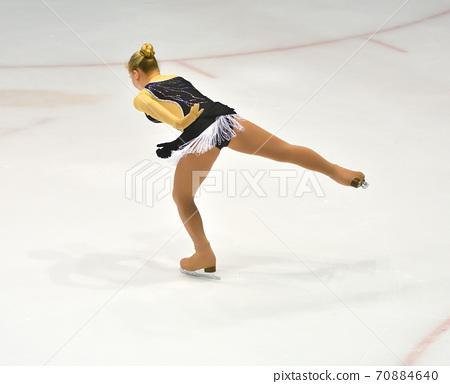 Girl figure skating 70884640