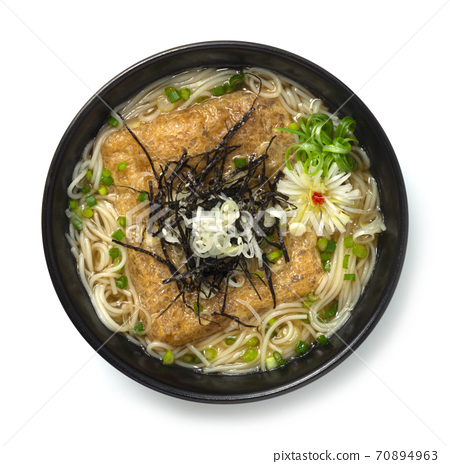 Japanese noodle soup in  dashi broth (Kitsune ramen) topped with seasoned fried tofu 70894963