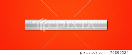 Metal ruler isolated on red background 70899524