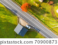Aerial view of beautiful road in green hills at sunset in autumn 70900873