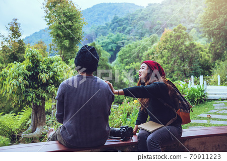 Asian couple travel photograph nature education. nature relax and study read a book. at public park. In Thailand 70911223