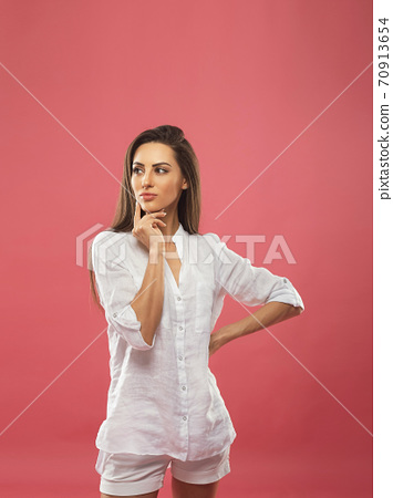Portrait of dream dreamy nice pretty cute lady youth people touch chin thought choose decide solve problems dilemmas wear fashionable outfit isolated pink background 70913654