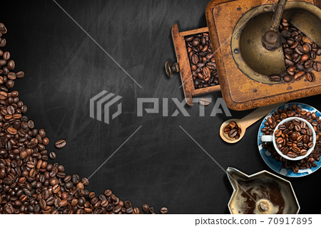 Coffee Grinder and Cup with Roasted Coffee Beans on a Blackboard 70917895