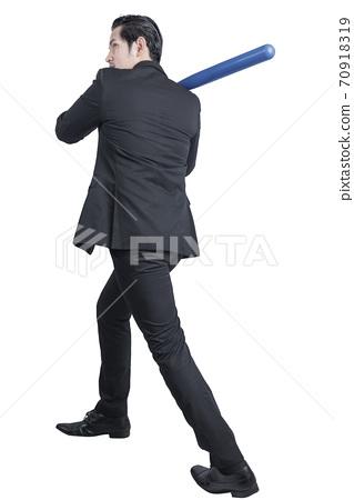 Asian businessman holding a baseball bat 70918319