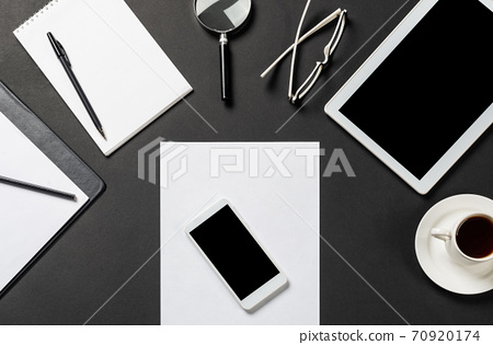 Top view of modern workplace with blank paper 70920174