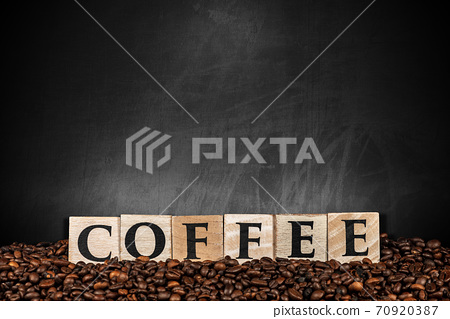 Roasted Coffee Beans and Wooden Text Coffee on Empty Blackboard 70920387