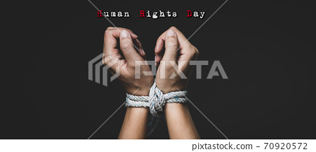 Woman hand tied up with rope, depicting the idea of freedom of the press or freedom of expression on dark background in low key. International human right day concept. 70920572