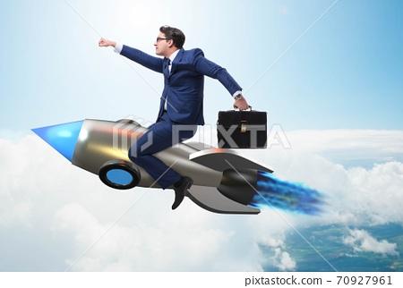 Businessman flying on rocket in business concept 70927961
