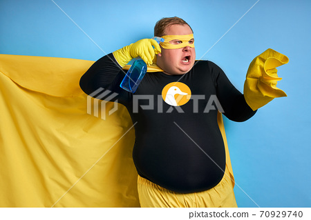 portrait of obese man with detergents isolated 70929740