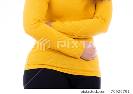 Woman suffering from stomach pain and injury isolated white background. 70929791