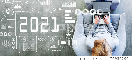 2021 New Year concept with man using a laptop 70930296