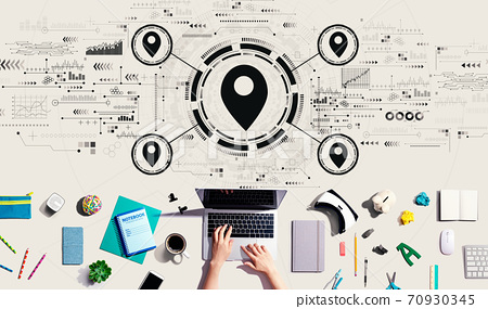 Map pin concept with person using a laptop 70930345