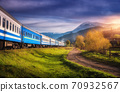 Moving train in mountains at sunset in autumn. Railway station 70932567