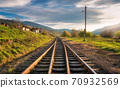 Railroad in mountains at sunset in autumn 70932569