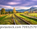 Railroad in mountains with snowy peaks at sunset in autumn 70932570