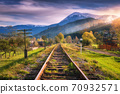Railroad in mountains with snowy peaks at sunset in autumn 70932571