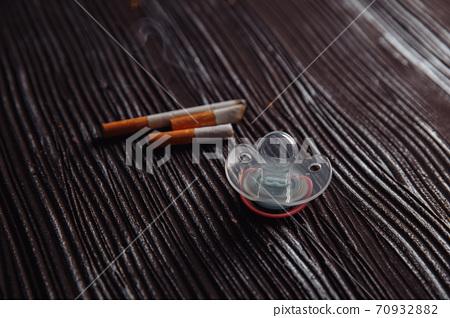 Maternity and broken cigarette. Dangerous habbit concept 70932882
