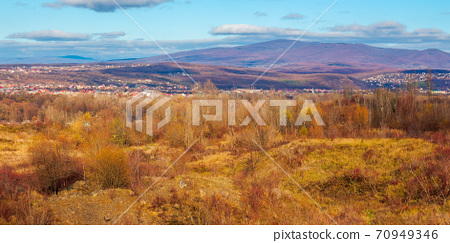 rural valley in the morning. beautiful autumn scenery in mountains. town in the distant valley. clouds on the blue forenoon sky 70949346