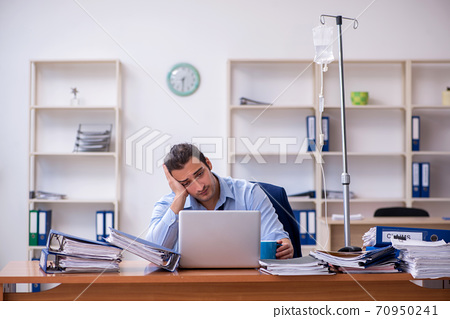 Young male employee suffering at workplace 70950241