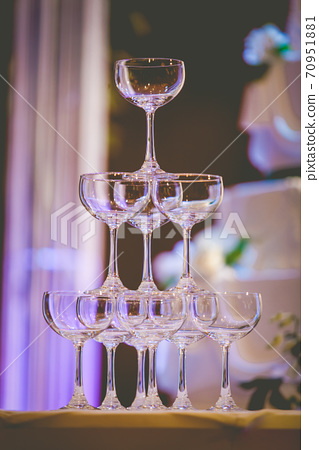 A glass of champagne at a party celebrating the wedding 70951881