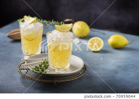 Cocktail with lemon, timo and crushed ice 70959044