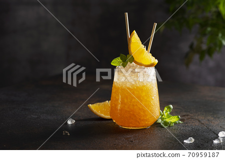 Fresh cold cocktial with orange, crushed ice and mint 70959187