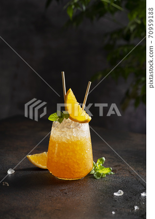 Fresh cold cocktial with orange, crushed ice and mint 70959188