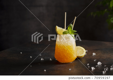 Fresh cold cocktial with orange, crushed ice and mint 70959197