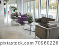 Empty airport terminal waiting area with comfortable furniture 70960226