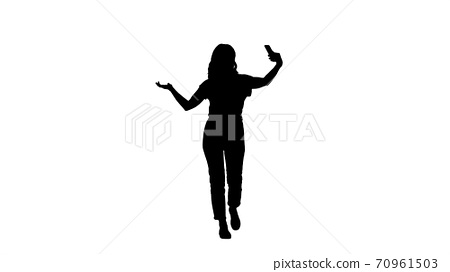 Silhouette Cheerful young hipster girl streaming video for inter 70961503