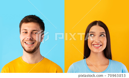 Portrait of smiling couple posing on yellow and blue background 70963853