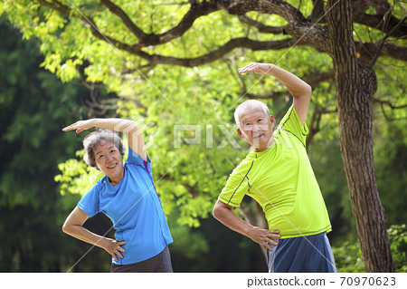 Happy Senior  couple exercising in the nature park 70970623