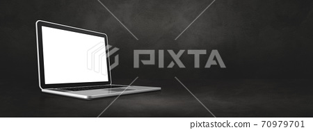 Laptop computer on dark concrete office scene background banner 70979701
