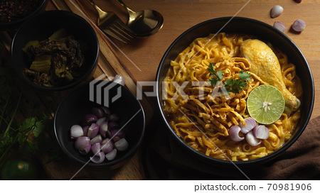 Northern Thai food, Noodles curry soup with Chicken (Khao Soi) served with side dish 70981906