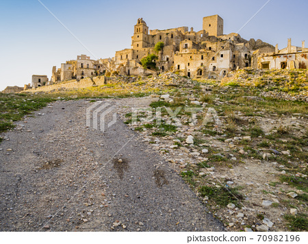 Dramatic view of Craco ruins, ghost town abandoned towards the end of the 20th century due to natural disaster, Basilicata region, southern Italy 70982196
