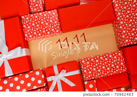 Frame of red gift boxes on yellow background with copy space for text 11.11 single's day sale. 70982463