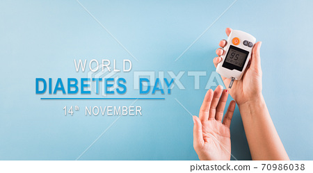 World diabetes day awareness concept. The diabetic measures the level of glucose in the blood, 14 November. 70986038