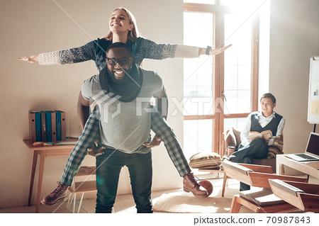 African American man with woman having fun.  70987843