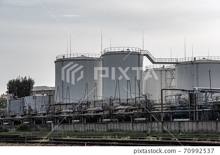 Tanks oil storage against the solf sky. Storage tanks for petroleum products. Equipment refinery. 70992537