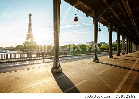 Eiffel Tower from Bir-Hakeim metal bridge in the morning, Paris, France 70992868
