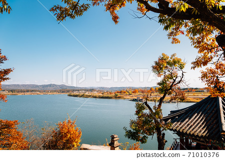 Namhan River and mountains with autumn maple from Silleuksa Temple in Yeoju, Korea 71010376