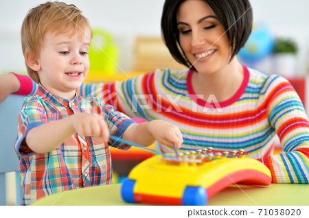 Young mother and cute little son playing 71038020