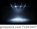 Winter background. Spotlight shines on the rink. Bright lighting with spotlights. Beautiful empty winter background and empty ice rink with lights 71043447