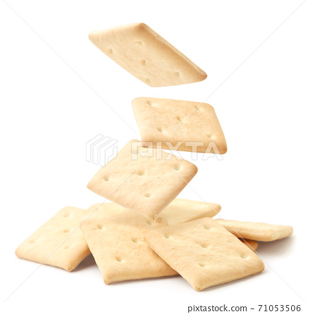 Square crackers fall on a heap on a white background. Isolated 71053506