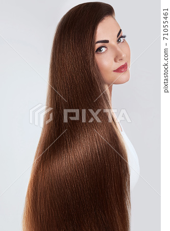 Hair.Beautiful woman with luxurious long hair. Gorgeous Model Girl with Healthy brown smooth shiny straight Hair. Keratin straightening.Treatment,care. Smooth Hairstyle. 71055461