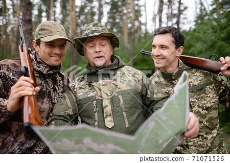 Hunters Enjoy Active Recreation Looking at Map. 71071526
