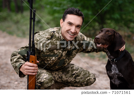 Dog Hunt Concept Good Pointer and Happy Owner. 71071561