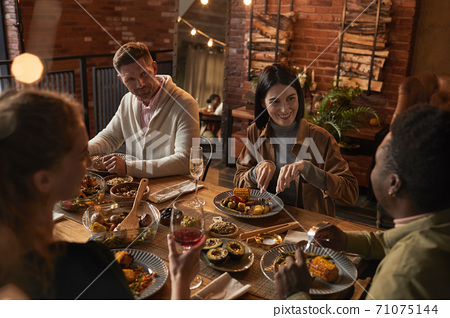 Adult People Enjoying Dinner Party 71075144