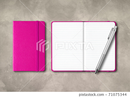 Pink closed and open lined notebooks with a pen on concrete background 71075344