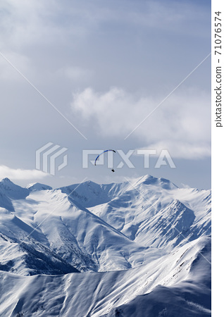 Sky gliding in winter mountains 71076574